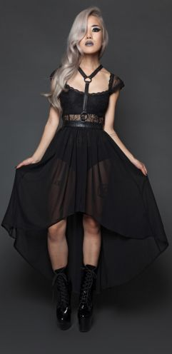 Fall From Grace halter harness with skirt layered on top of Black Romance bodysuit, both by Lip Service