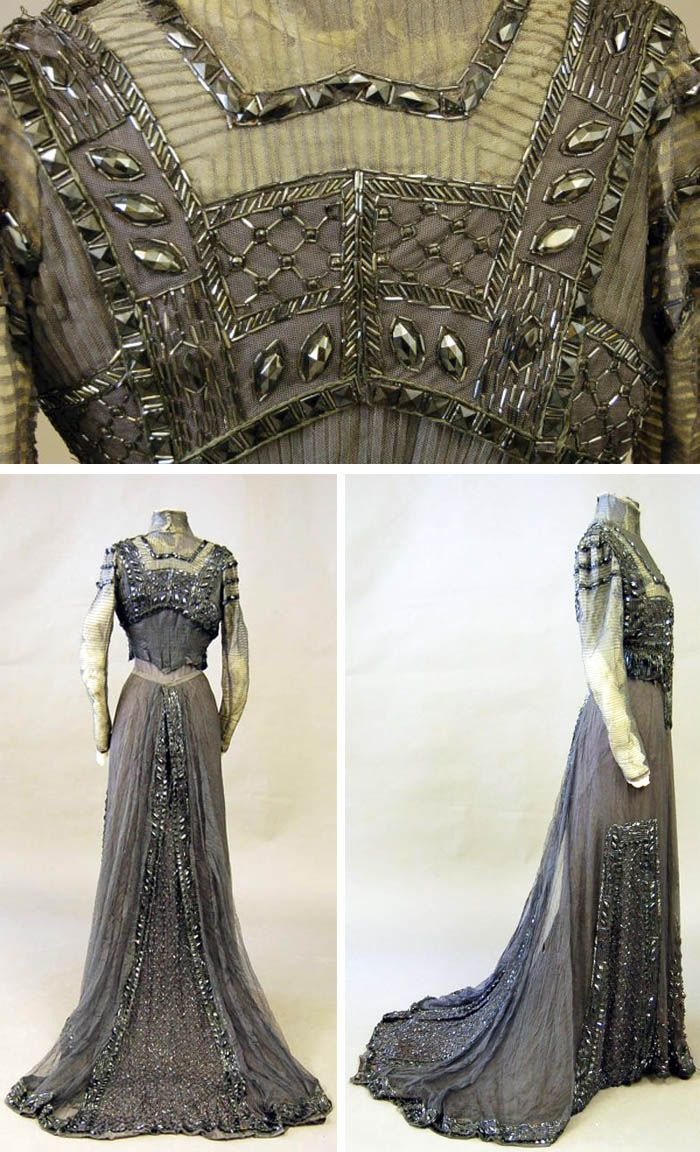 ~Circa 1901-1905 high-necked gown of gray tulle made for Queen Alexandra of Britain by Nicaud Maubant & Dugdale Freres, Paris. Large faceted pewter gray glass beads and fringes on bodice and skirt. Via Kerry Taylor Auctions~