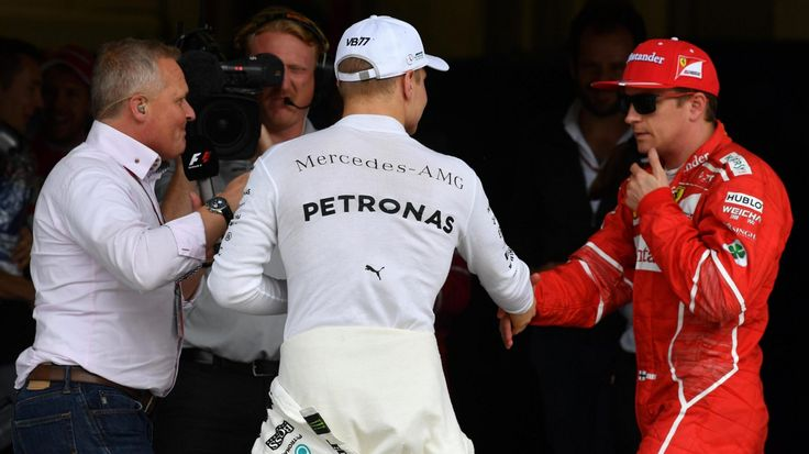 Pole sitter Valtteri Bottas celebrates with Kimi Räikkönen in parc fermé as Johnny Herbert from Sky TV looks on at Interlagos, São Paulo, Brazil - Saturday 11 November 2017