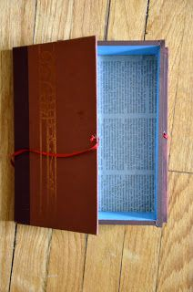 DIY Projects: How -To: Turn an Old Book into a Book Box.  This would make a good geocache hide in your local library (just get permission from the library first, and check with your reviewer to make sure they don't consider a library a business).