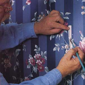 thisoldhouse.com shows us Wallpaper Repairs Made Easy. Like how to flattened and re-glue a peeled seam.