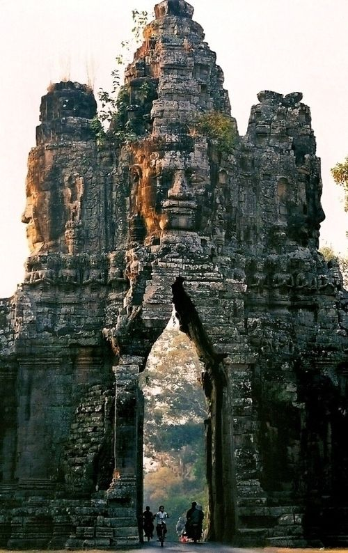 "Gate of Angkor Thom, Cambodia. Angkor Thom means ""the great city"" in Khmer. The 12th-century royal Buddhist city is especially famed for its grand Bayon Temple.  The city of Angkor Thom was founded by Angkor's greatest king, Jayavarman VII (reigned 1181-1219). At its height, Angkor Thom may have governed a population of one million people in the surrounding area."