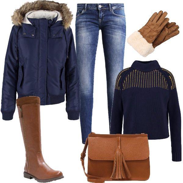 Color cognac e sensazione di calore per questo look. Color cognac sono gli stivali in finta pelle con inserto in tessuto, la borsa a tracolla e i guanti in fintapelle con ecopelliccia. Davvero comoda e calda la giacca invernale blu, con cappuccio bordato da pelliccia sintetica. Abbiniamo un meraviglioso maglioncino blu a collo alto e dei comodi blu jeans.