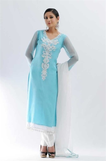 Chiffon blue and white straight cut kameez with narrow, straight leg trousers. The kameez is a summery sky blue with white work on the front of the shirt. There are white hangling resham balls on the hem of the kameez.  The sleeves are sheer blue with white balls and black trim cuff.   £49.99