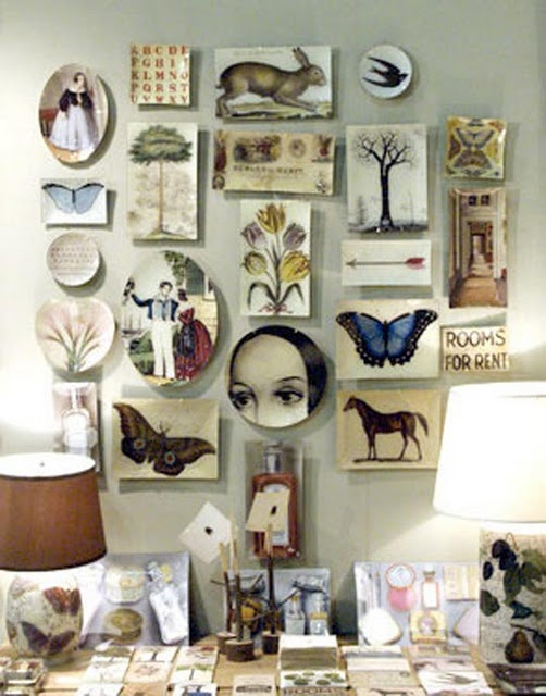 love this feature wall! I've done something similar with old family photos, but I never thought to throw plates/antique calander pages in etc.