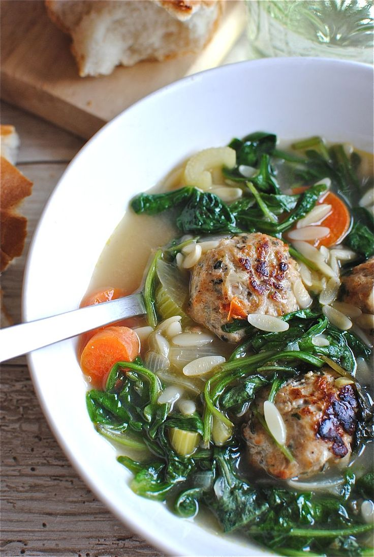 italian wedding soup with basil chicken meatballs, garlic, and baby spinach