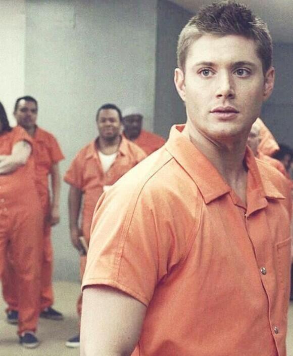 Dean Winchester..making a fashion statement in an orange prison jumpsuit..Supernatural