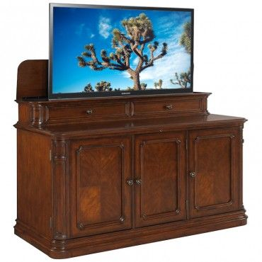 the rich brown undertones featured in the banyan creek make this elegant tv lift cabinet a must have