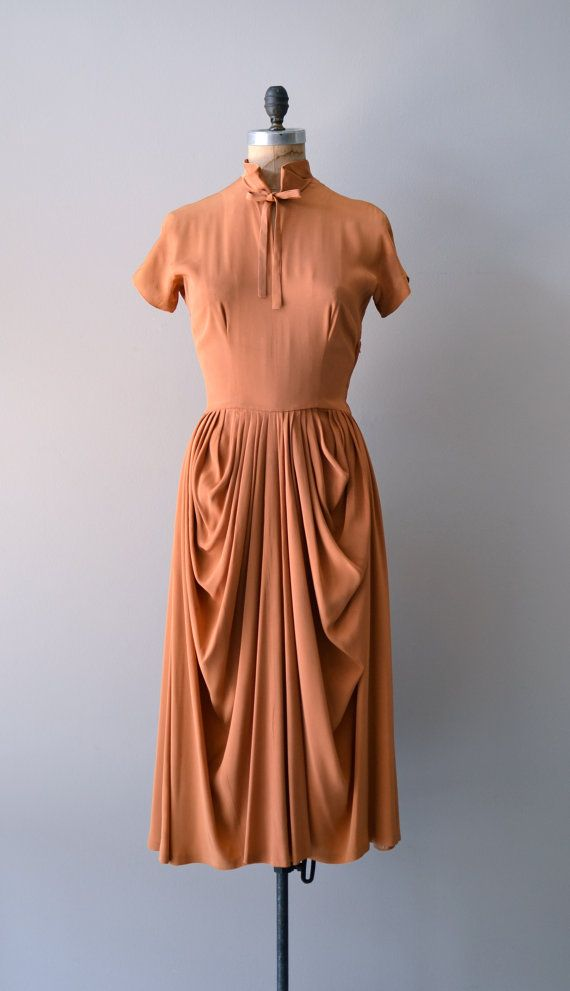 vintage 1950s Ceil Chapman terra cotta rayon dress with classic and impeccable Ceil Chapman draped skirt. high collar with tie, short sleeves, bust