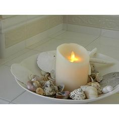 Perfect for the bathroom. Flameless though they may be, these candles are constructed from real wax and have the most beautiful natural scents. This ivory version is Deliciously Scented with Vanilla. Yum #flamelesscandles