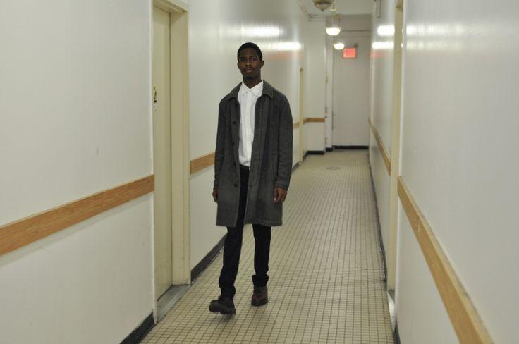Comme des Garcons coat, Uniqlo oxford button-down, +J by Uniqlo trousers, and mismatched Comme des Garcons x Doc Martens shoes