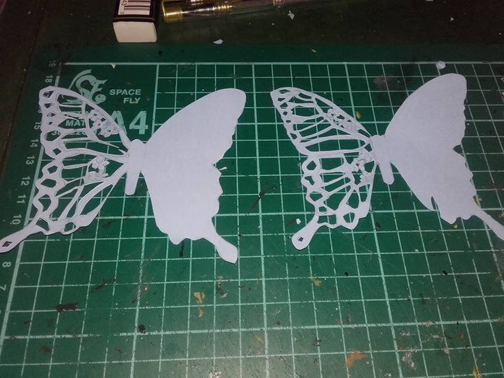 Butterfly place cards with filigree work created by hand.