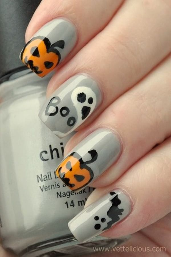 Give life to your nails w this Halloween with this spooky looking nail art. Use gray polish as your base coat and paint your heart way with ghosts and creepy pumpkin heads on top.
