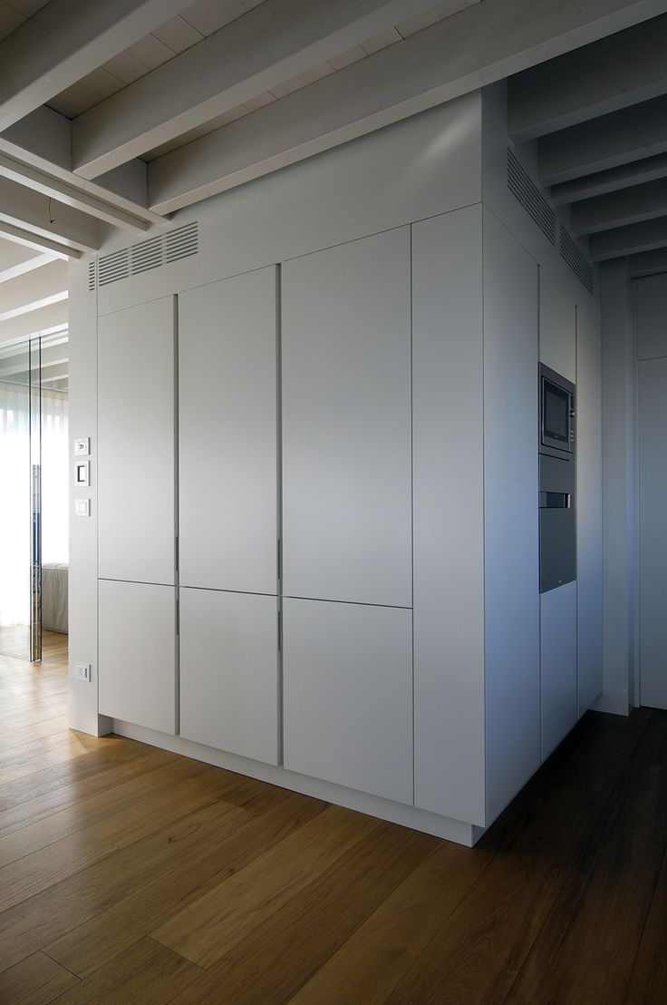 kitchen TIME 45° - this large block was custom made to fit around the characteristic ceiling beams, it optimises available space by housing the refrigerator and pantry on one side and oven and blast chiller on the other