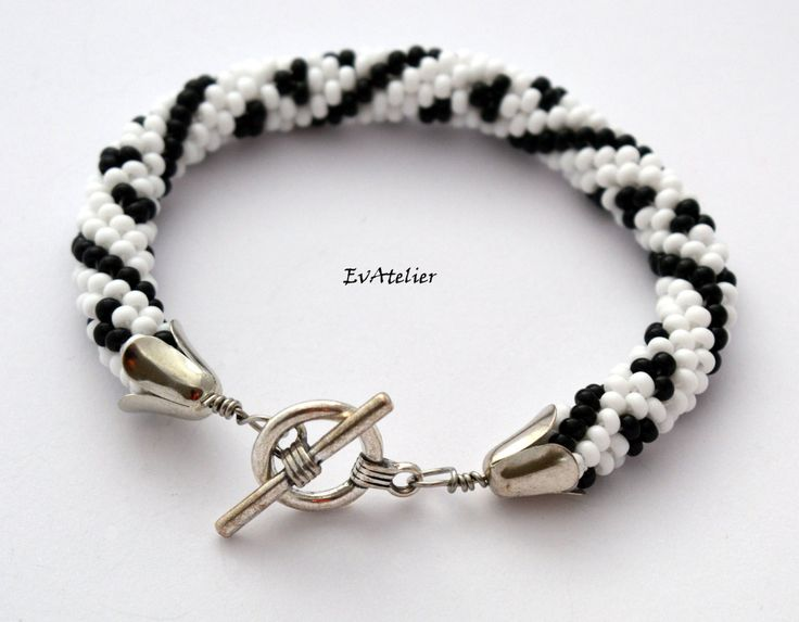 New bracelet that fits a Zen necklace! by EvAtelier1 on Etsyhttps://www.etsy.com/listing/259312511/black-and-white-zen-necklace-bead?ref=shop_home_active_1