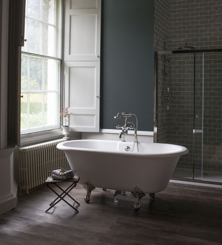 My future bathroom will have both a roll top bath and a shower. I would love to have this much space in my bathroom. The windows are beautiful too.