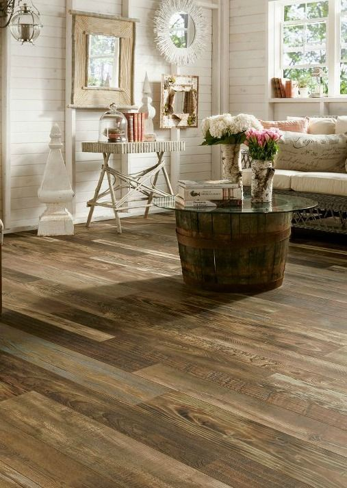 Mixed wood species in are shown in this gorgeous laminate flooring from Armstrong - Woodland Reclaim from the Architectural Remnants Collection.
