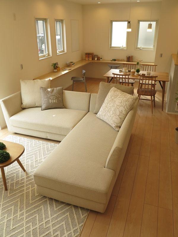 L字のカウンターとL型のソファがつながったような家具の配置提案