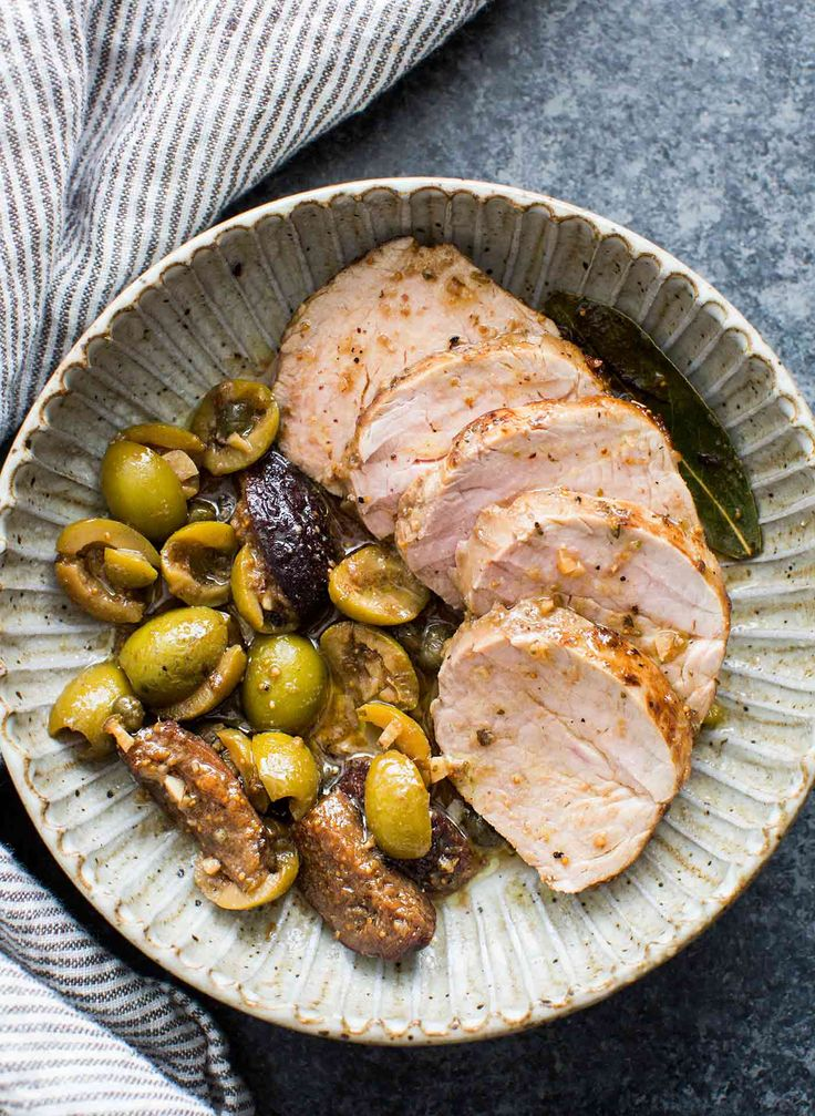 Marinated Pork Tenderloin with Figs and Olives is a classic Mediterranean dish. It's tangy, sweet, and savory, and filled with flavor! Easy to make, elegant presentation. Perfect for a special meal!
