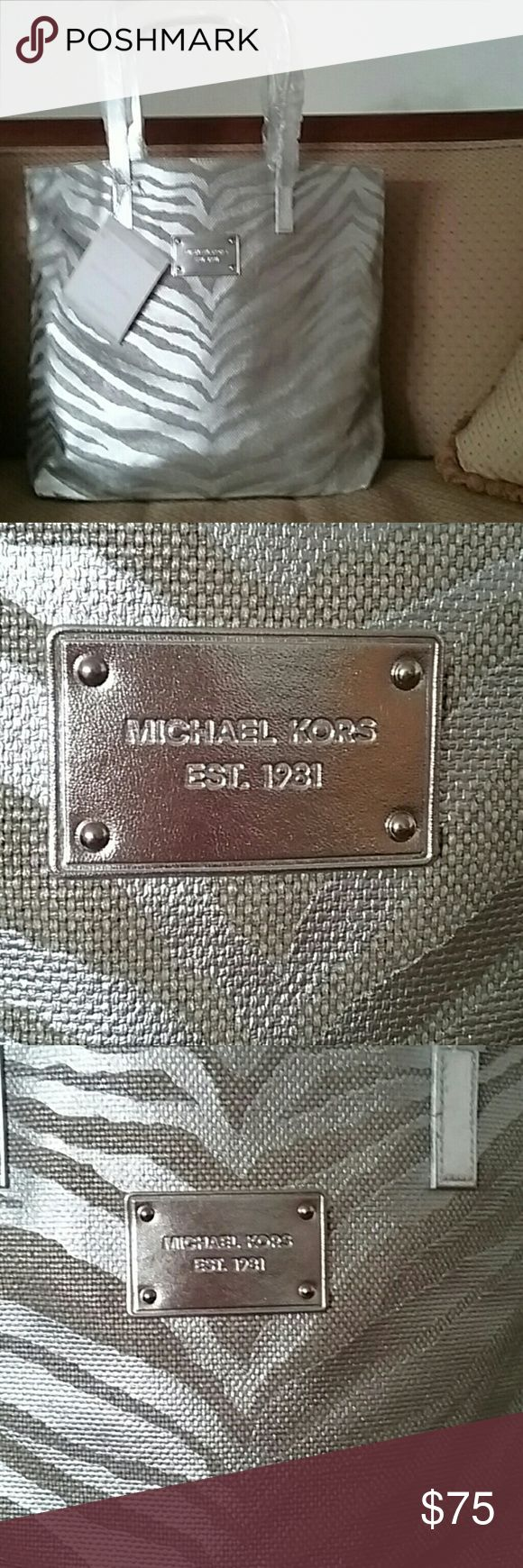 Michael Kors Tote Authentic Fabulous Michael Kors tote bag. Constructed of silver and taupe canvas. Animal print with silver handles. Dementions 15x13x5. Great grab and go bag. Price firm no offers please. Michael Kors  Bags Totes