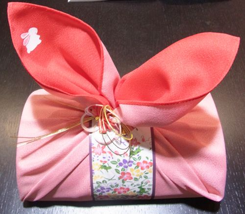 Dried bonito flakes are one of the celebratory items in Japanese wedding. Here it's wrapped in clothes to look like a rabbit.