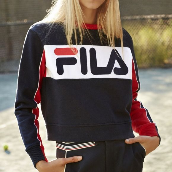 FILA X UO Sweatshirt A FILA X UO collaboration. Really cute red and blue sweatshirt. It's cropped a little. Worn a few times, in great condition. Currently sold out from UO stores. The tag says size medium but it fits more like a small Fila Sweaters Crew & Scoop Necks