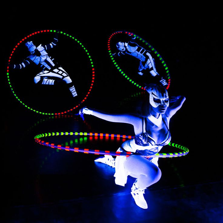 Cyr Wheel performance under black light. Crystal Light Show - Anta Agni.