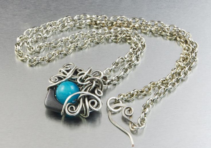 "Gorgeous silver plated pendant, with heart shaped Hematite, blue Jade, in a original silver braid. Beautiful, remarkable pendant, for a woman who likes unique jewelry :) Length of the chain - 50 cm (19.69""); Pendant diameter is - 3 cm x 3 cm (1.18"" x 1.18""); Material: 925 sterling silver plated copper wire ; Stone: Jade; On request I make a similar pendant in other material - silver, copper, brass, silver-plated copper, bronze. Interested persons are welcomed to contact :)"