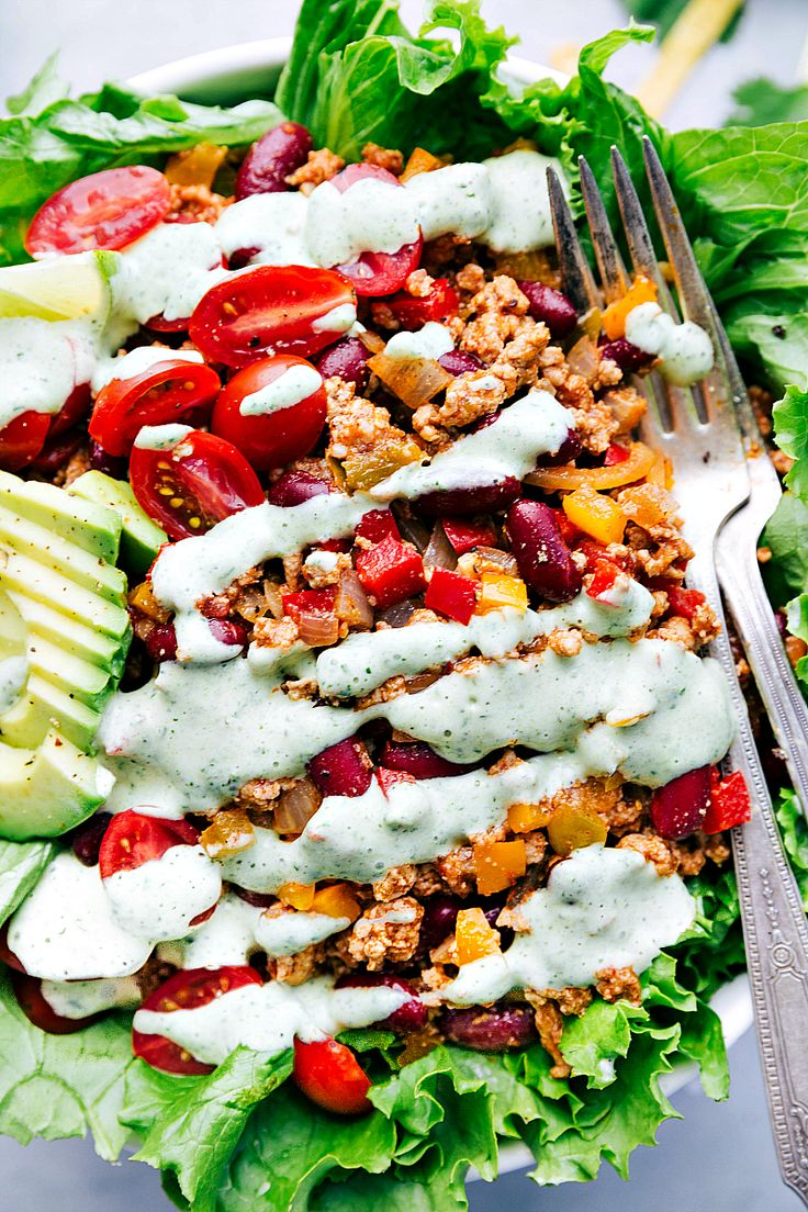 The most delicious and healthy turkey taco salad packed with veggies and an amazing cilantro dressing! Video Tutorial Included.
