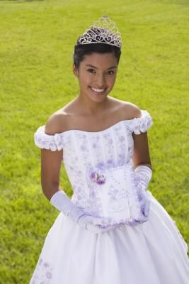 """The word debutante describes a young woman who has reached the age at which she can be presented to society as an adult. The word itself is French, most literally the feminine meaning """"one who makes a first appearance."""" Though debutante events traditionally signaled that a girl was at an appropriate age to start considering marriage, at their most basic, debutante traditions are coming-of-age events."""