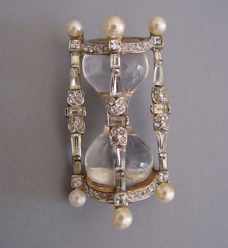 "TRIFARI jelly belly hour glass brooch with clear rhinestones and artificial pearls, marked ""Trifari, pat pend"", 1-3/4"" pat 153,500, circa 1949"