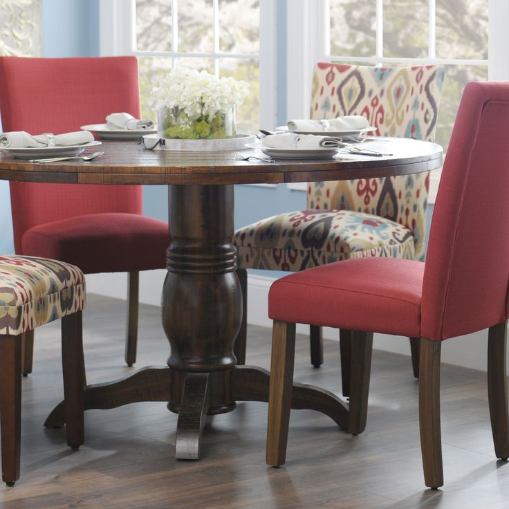 stylist kitchen table with wine storage. Have some fun with your dining room decor by adding colorful Parsons chairs  to dinner table Plus mix and match different styles for an even more 100 best Creative Kitchens images on Pinterest