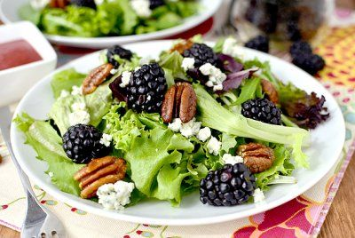 Black & blue spring salad with honey roasted pecans and Berry-balsalmic vinaigrette