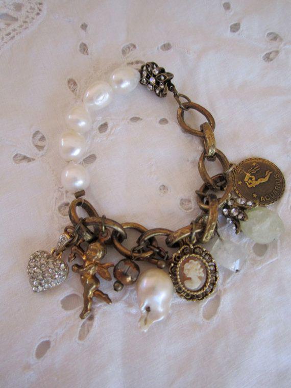 vintage repurposed jewelry charm bracelet pave heart cupid aquarius baroque pearl aquamarine butterfly clasp valentines gift. $93,00, via Etsy.