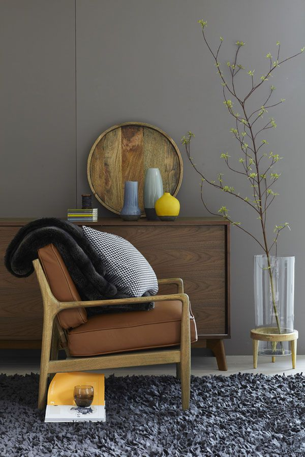 Danish leather chair + shaggy rug + gray wall.