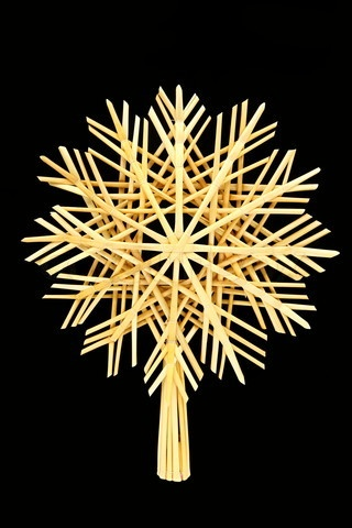 Stock image of 'Christmas straw star isolated on black background'
