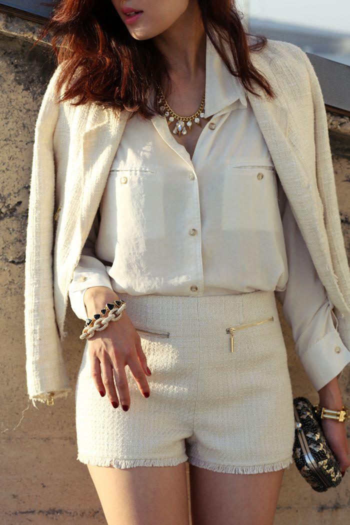 what-do-i-wear:    Jacket- Zara,Blouse-DailyLook,Tweed Shorts-DailyLook,Crystal Necklace-T+J Design,Link Bracelet-T+J Design,Clutch-Juicy Couture,Gold Tube Bracelet (Left hand) – Roman Luxe,Triangular Jet Bracelet (right)-Roman Luxe,Triangle Jet Stud Earrings-Roman Luxe(image:thechrisellefactor)
