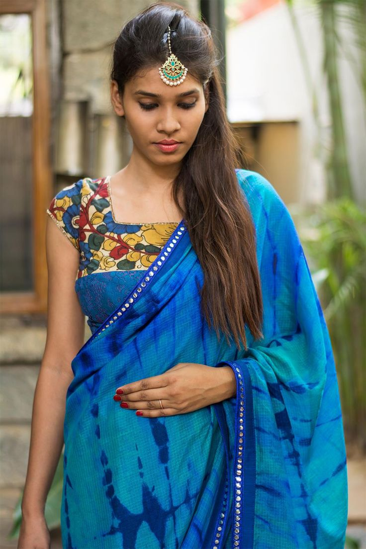 """Detail magic at work again! With a cool #kalamkari yoke on a blue cotton lace body and a striking sheer net back having a kalamkari appliqué, this blouse is full of surprises. Pair with any blue saree. Or pick a color in the kalamkari work and own your style!"" #houseofblouse"