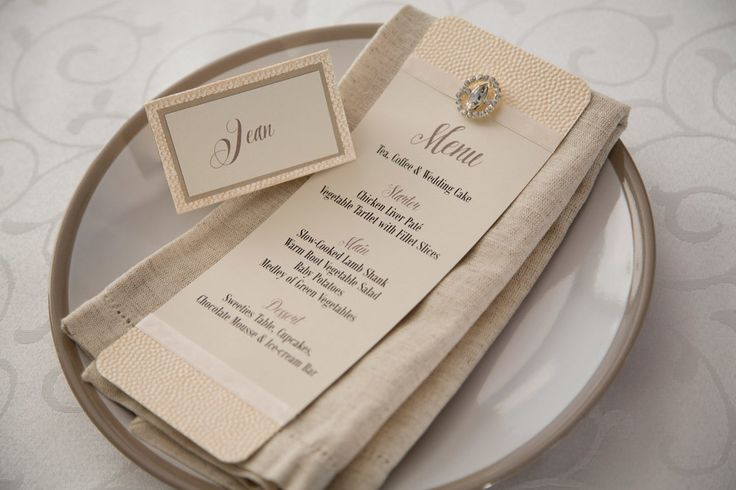 Menu and place-card made from bling diamante ivory cotton paper menu with champagne coloured textured paper and ivory satin ribbon touches. Photo by Rikki Hibbert