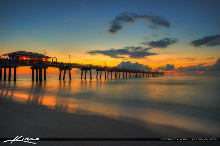 Beautiful warm sunrise over  the ocean by the Dania Beach Pier in Broward County, Florida. HDR image tone mapped using Aurora HDR software.
