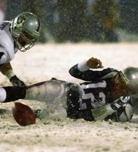 New England Patriots quarterback Tom Brady (12) loses the ball after being brought down by Oakland Raiders' Charles Woodson, right, while Greg Biekert (54) moves to recover the ball in the fourth quarter of their AFC Division Playoff game in Foxboro, Mass. Saturday night, Jan. 19, 2002. The play was appealed, and the Patriots retained possession. The Patriots return to the playoffs on Saturday night, Jan. 10, 2004, when the Tennessee Titans come to Foxboro for a night game that will be…