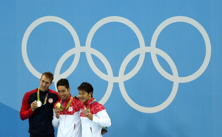 (L-R) Silver medalist Chase Kalisz of the United States, gold medal medalist Kosuke Hagino of Japan and bronze medalist Daiya Seto of Japan pose during the medal ceremony for the Final of the Men's 400m Individual Medley on Day 1 of the Rio 2016 Olympic Games at the Olympic Aquatics Stadium on August 6, 2016 in Rio de Janeiro, Brazil.