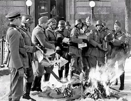 Fake Germans gleefully burned a pile of books in front of the main branch of the Winnipeg Public Library (Don't worry -- these books had been pre-selected for incineration as damaged or outdated). It was part of a huge staged invasion in Winnipeg on Feb. 19, 1942 called IF Day, designed to scare people into donating money to Victory Loans.