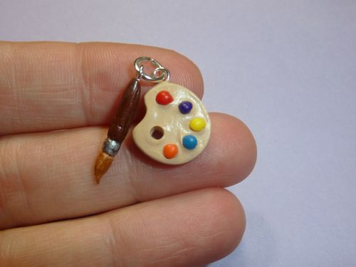 Paint pallet and paint brush polymer clay charm. For more information please visit www.CharmingSculptHers.com #polymerclay #charms