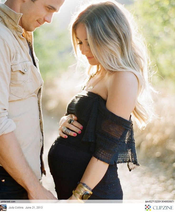 he looks at her face, she looks down at belly. Also....when I have kids someday...I NEED this dress