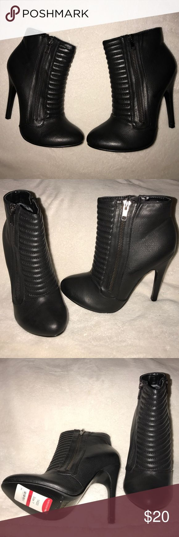 Size 7 Women's Armani Exchange New York Booties NWT size 7 Armani Exchange New York booties. Black in color with 4.5inch heels. Bought at Nordstrom Rack. Armani Exchange New York Shoes Ankle Boots & Booties