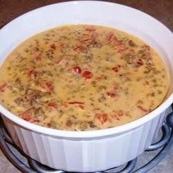 Rotel Cheese Dip -  1lb Velveeta, 10oz can of Rotel Diced Tomatoes & Green Chilies, 1lb Spicy Ground Pork Sausage.  Cook the meat and throw in a crock pot with ingredients.