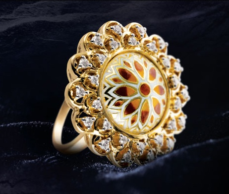 Gold ring with a coloured enamel centre embraced by two rows of diamonds -  from Tanishq\'s