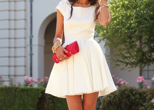 White dress with bright red clutch