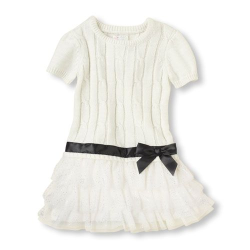 Classic cable-knit, a tutu skirt and allover shimmer make this fancy sweater dress a must-have!